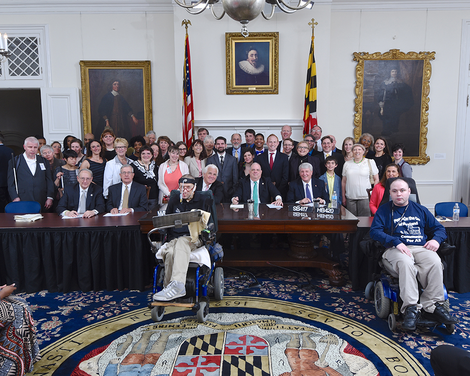 Group photograph of many people in Maryland statehouse for SB-417-HB-420