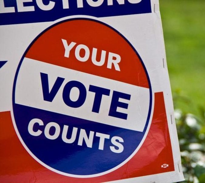 "Lawn sign that reads ""your vote counts"""