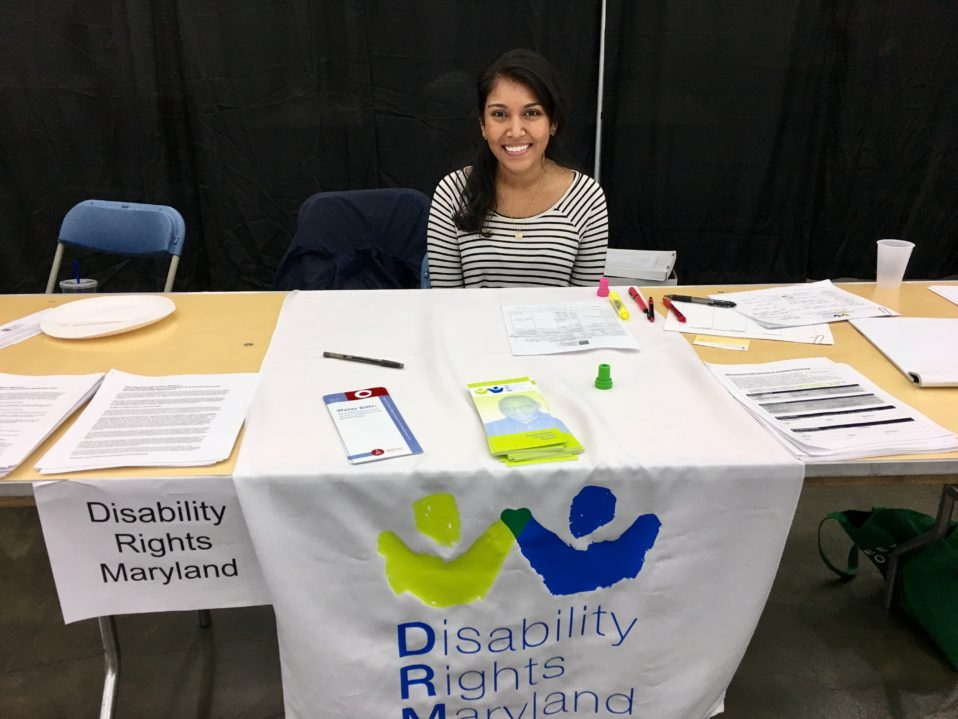 DRM intern Jessica Ramdat volunteering at the DRM table during the convention
