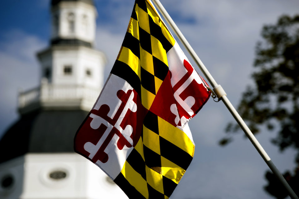 Maryland flag with building in the background