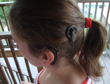 Young woman with a cochlear implant