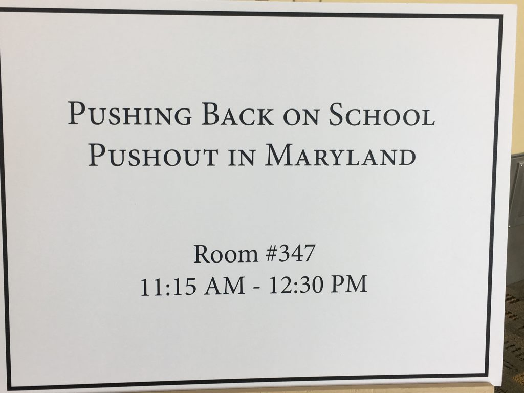 "Door sign for ""Pushing Back on School Pushout in Maryland"" panel discussion"